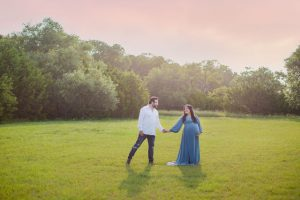 Emilia maternity session Kendall Point on the green at Sunset